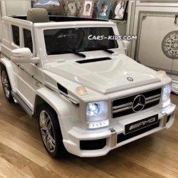 Электромобиль Mercedes-Benz G63 AMG белый глянец (колеса резина, сиденье кожа, пульт, музыка)